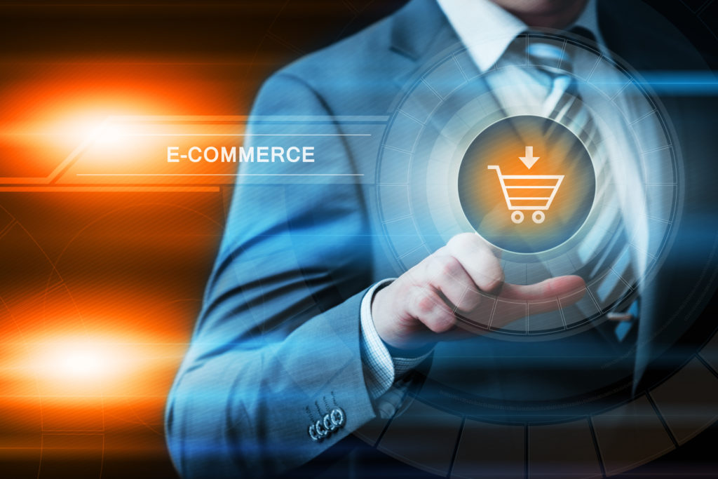 business, technology and internet concept - businessman pressing e-commerce button on virtual screens